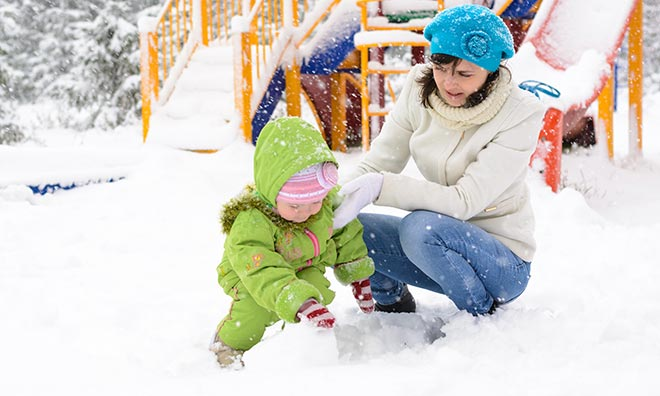 Mom and child playing in snow