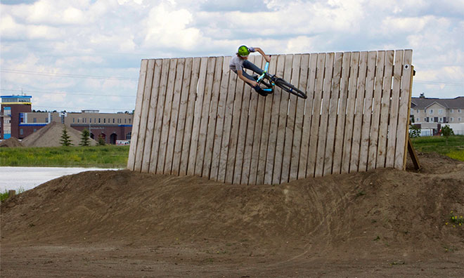 BMXer riding on vertical wall