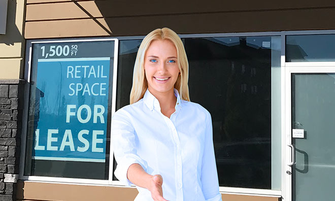 Business woman in front of retail space