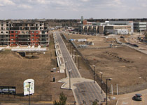 View of Prairie Walk from the roof of Festival Place in April 2011