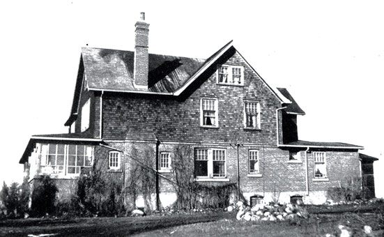 A black and white photo of the Bremner House
