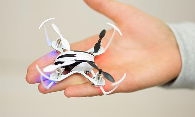 Mini-drone on the palm of a child's hand