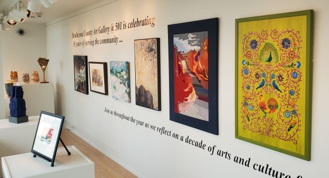 A display of artwork from the Strathcona County Art Collection in the Gallery@501 window space. Artwork includes a variety of paintings, sculptures.