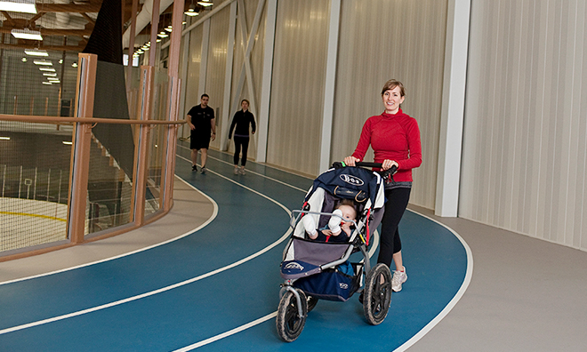 Woman walking on fitness track