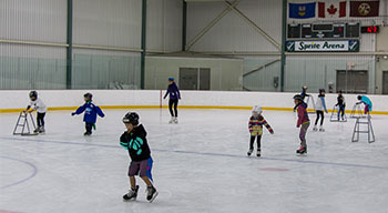 Kids skating in indoor arena
