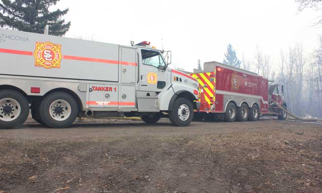 Tanker shuttle service for rural fire fighting