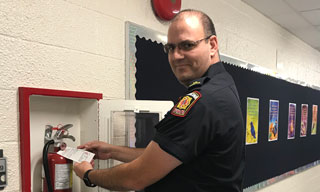 Fire Inspector checking a fire extinguisher