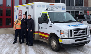Paramedics beside ambulance