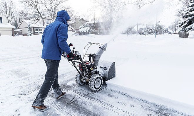 Person clearing snow with a snowblower