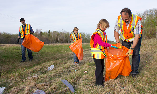 Group of volunteers cleaning up garbage