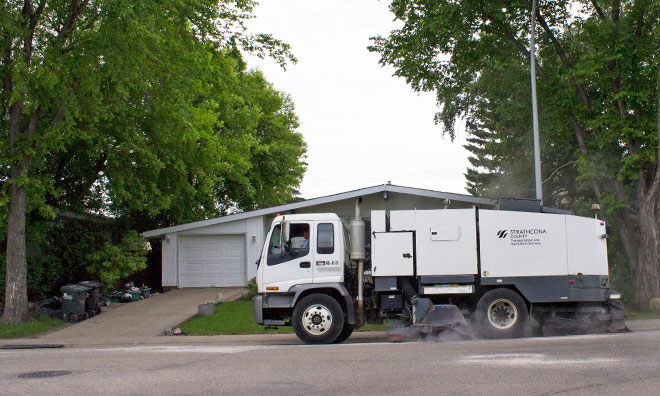 Street sweeper working on residential road