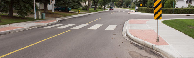 Image showing a curb extension on a residential street crosswalk to help with pedestrian safety