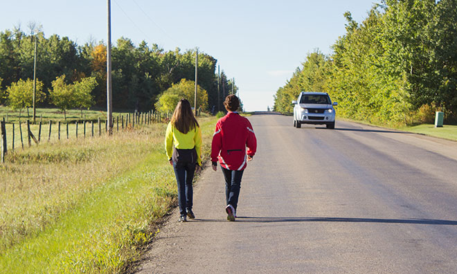 Image of pedestrians walking on rural road