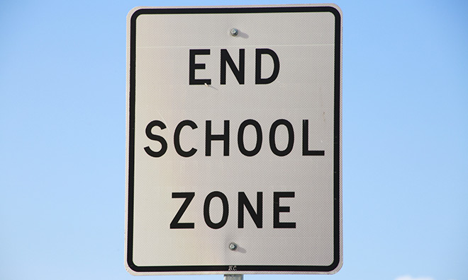 school zone end sign