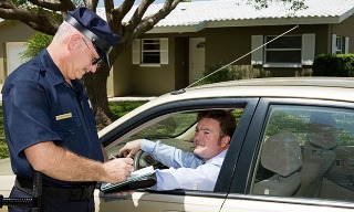 Image of officer giving a speeding ticket